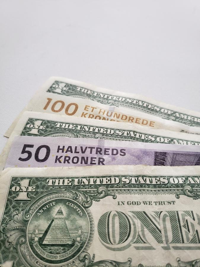 Approach to swedish banknotes and American one dollar bills. Commerce, exchange, travel, trade, trading, value, buy, sell, profit, price, rate, cash, currency stock photo