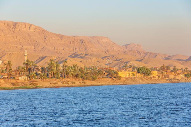 Approaching Al Miallah at the golden hour. Seen while navigating on the Nile stock image