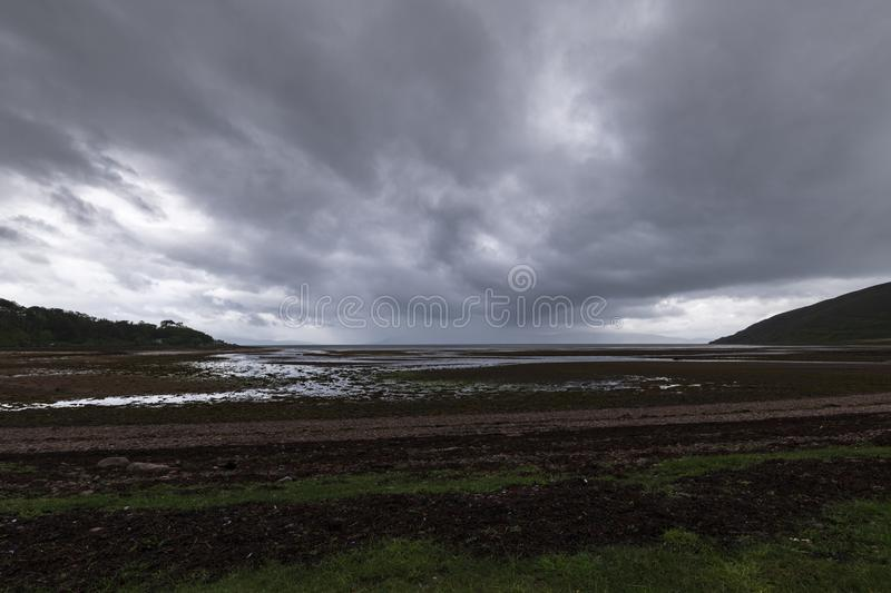 Applcross bay. Approaching summer rain across the Inner Sound towards Applecross bay in the Scottish Highlands stock photos