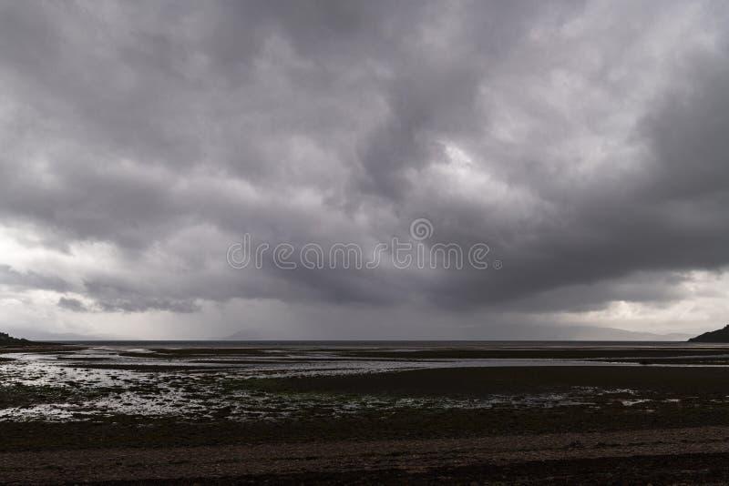 Applcross bay. Approaching summer rain across the Inner Sound towards Applecross bay in the Scottish Highlands stock photo