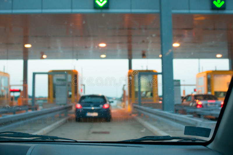 Approaching the toll booth. On summer afternoon royalty free stock photos