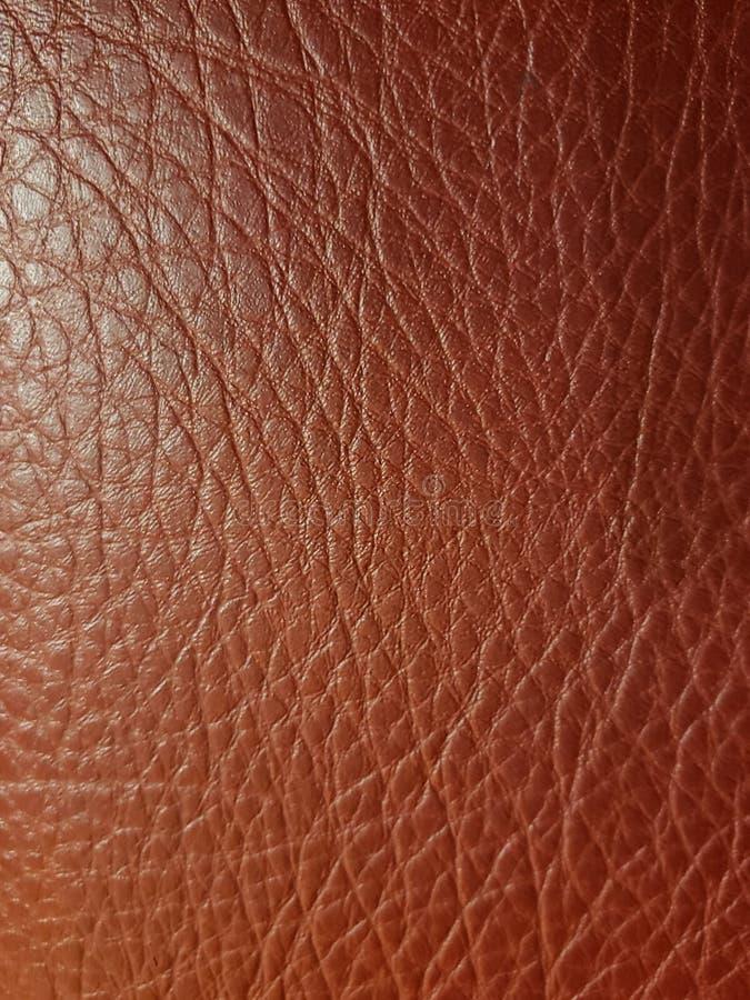 approche pour garnir en cuir la surface à la couleur, à l'arrière-plan et à la texture bruns photographie stock