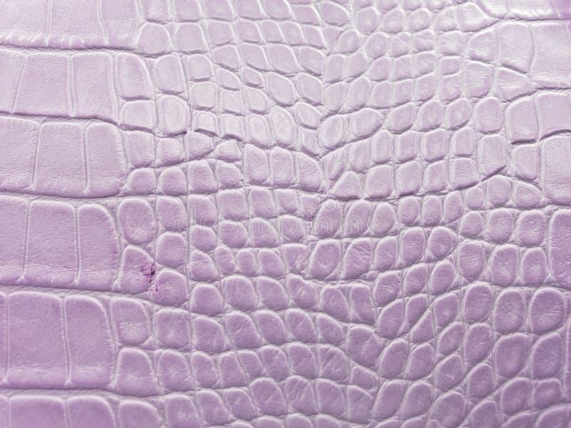 approche pour garnir en cuir la surface à la couleur, à l'arrière-plan et à la texture mauve-clair photo libre de droits