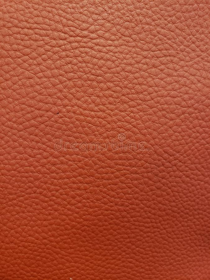 approche pour garnir en cuir la surface à la couleur rouge, à l'arrière-plan et à la texture photo stock