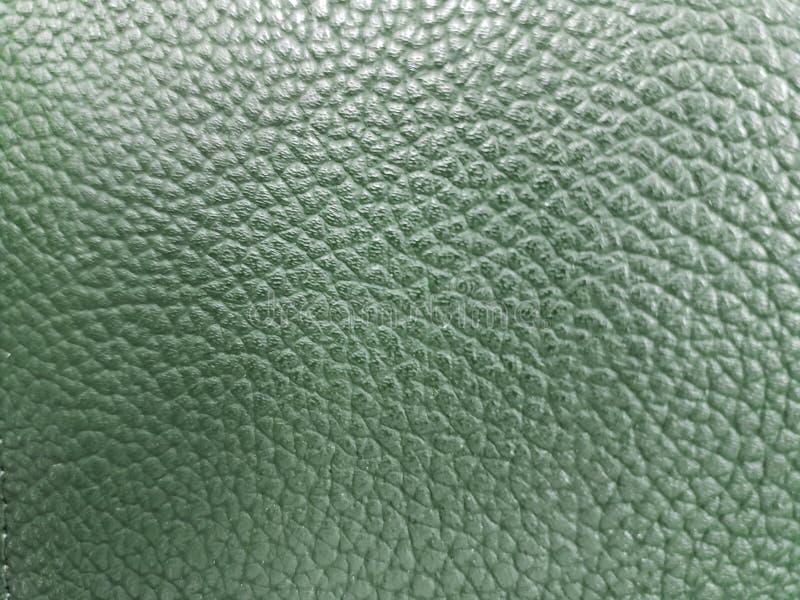 approche pour garnir en cuir la surface à la couleur verte, à l'arrière-plan et à la texture photographie stock libre de droits