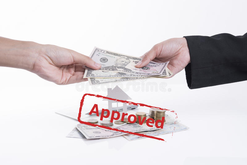 Approved mortgage loan agreement application with dollar money. And home royalty free stock image