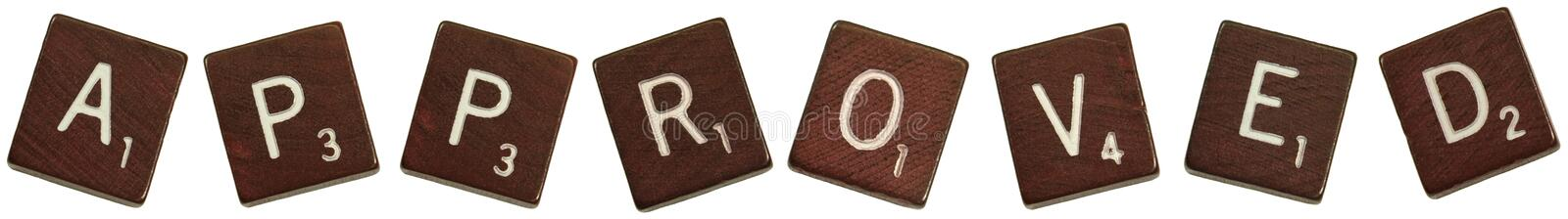 Approved tiles. Close up photo of tiles spelling out the word :approved royalty free stock image