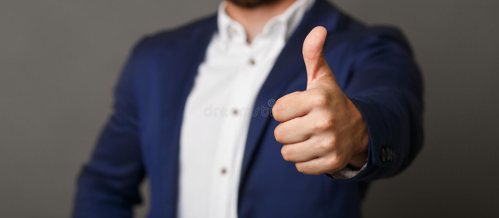 Unrecognizable businessman showing thumb up gesture panorama. Approved. Unrecognizable businessman showing thumb up gesture, panorama image stock photography