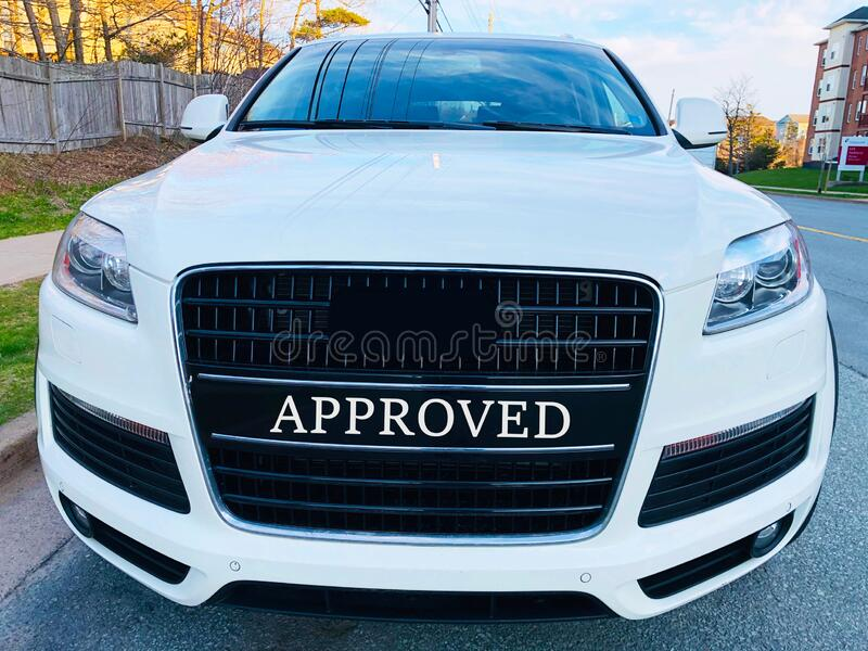 Approved used car for sale. An image of a used car for sale in sales area labeled with a bright black approved plate after servicing and valeting stock photo