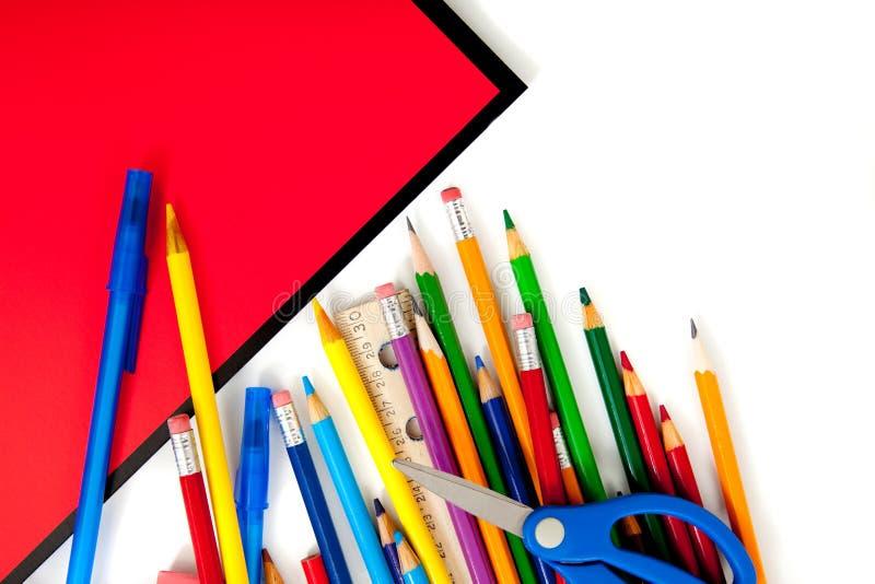 Approvisionnements d'école assortis avec des cahiers photos libres de droits