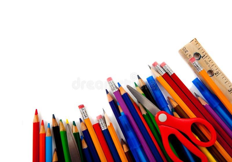 Approvisionnements d'école assortis sur le blanc photos libres de droits