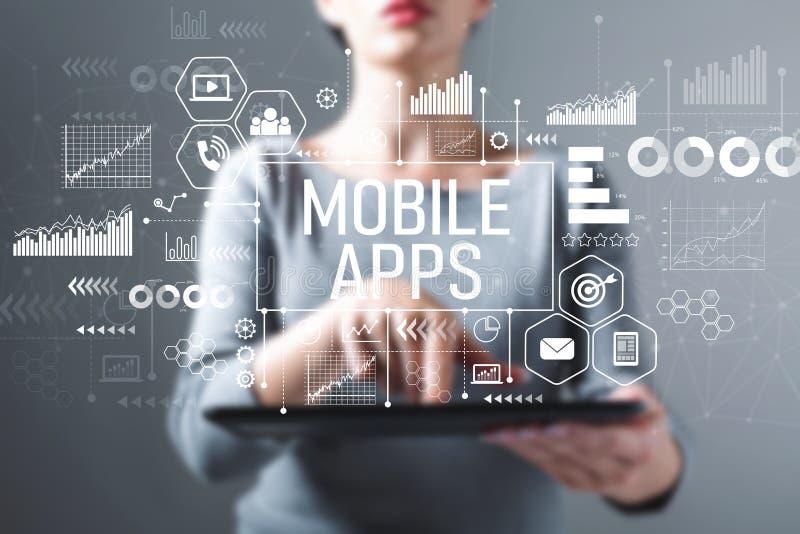 Apps móveis com a mulher que usa uma tabuleta fotografia de stock royalty free