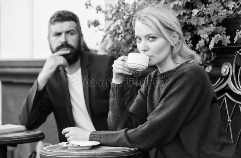 Apps normal way to meet and connect with other single people. Couple terrace drinking coffee. Casual meet acquaintance. Public place. Meeting people first date stock photo