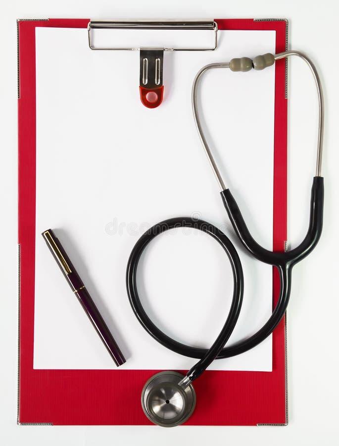 Appunti con lo stetoscopio moderno fotografia stock