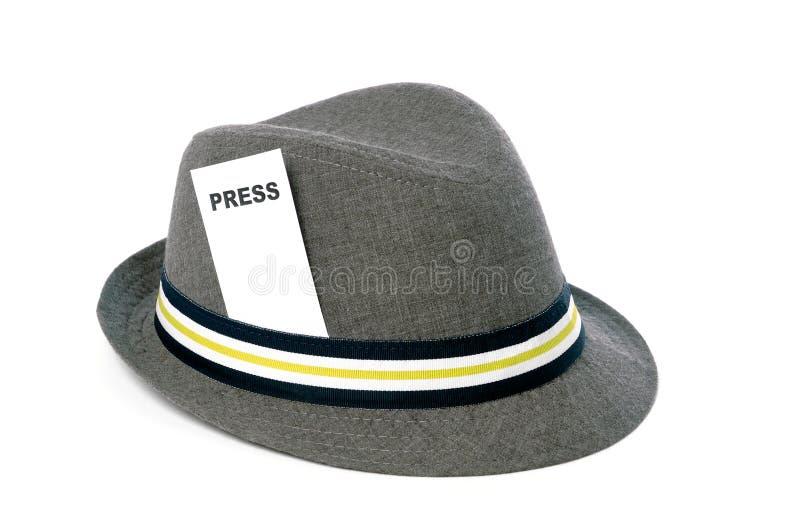 Appuyez le chapeau images stock
