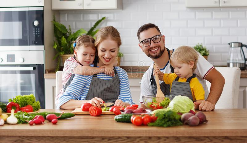Appy family with child preparing vegetable salad stock images