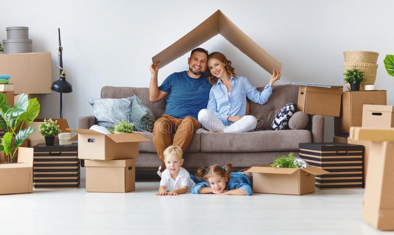 Happy family mother father and children move to new apartment an stock photos