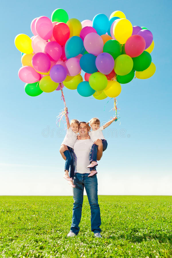 Appy family together in outdoor park at sunny day. Dad and two royalty free stock photos