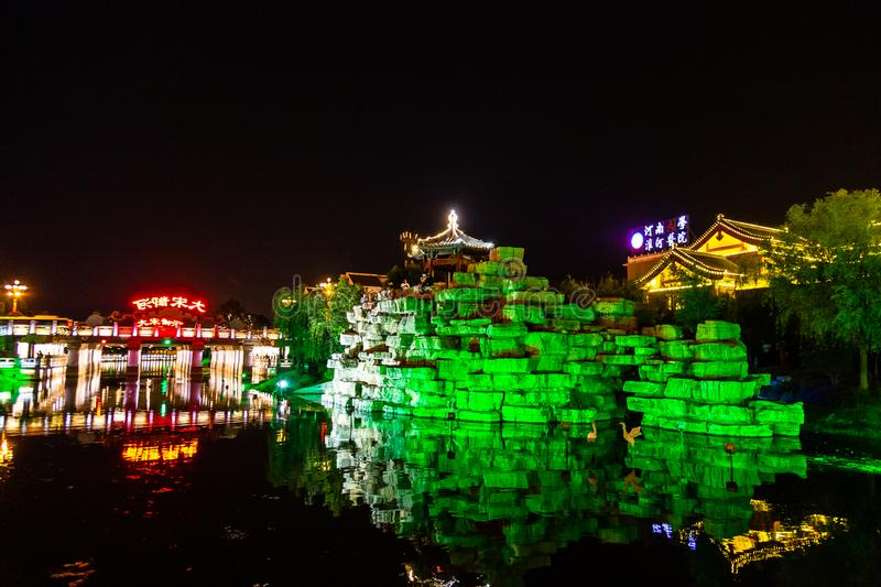 """Apr 2017 - Kaifeng, Henan, China - Qingming riverside in Kaifeng, known as """"Shui Xi"""", is beautifully lighted a night. Kaifeng was the capital of stock photo"""