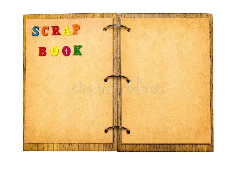 Apra il blocco note con gli strati di pergamena e dell'album per ritagli di parola di fotografia stock libera da diritti