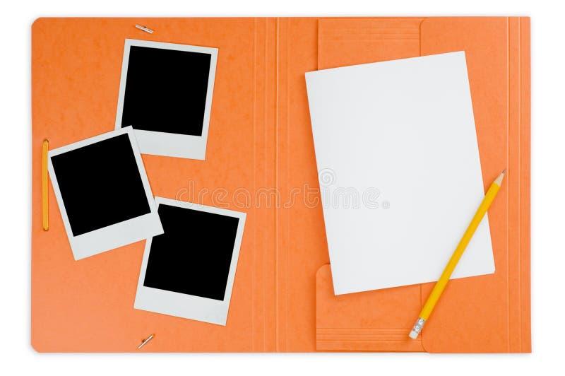 Apra il dispositivo di piegatura e le foto istanti immagine stock libera da diritti