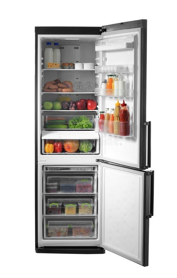 Apra il frigorifero in pieno di alimento fotografia stock