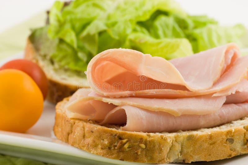 Apra il panino di prosciutto del fronte fotografia stock