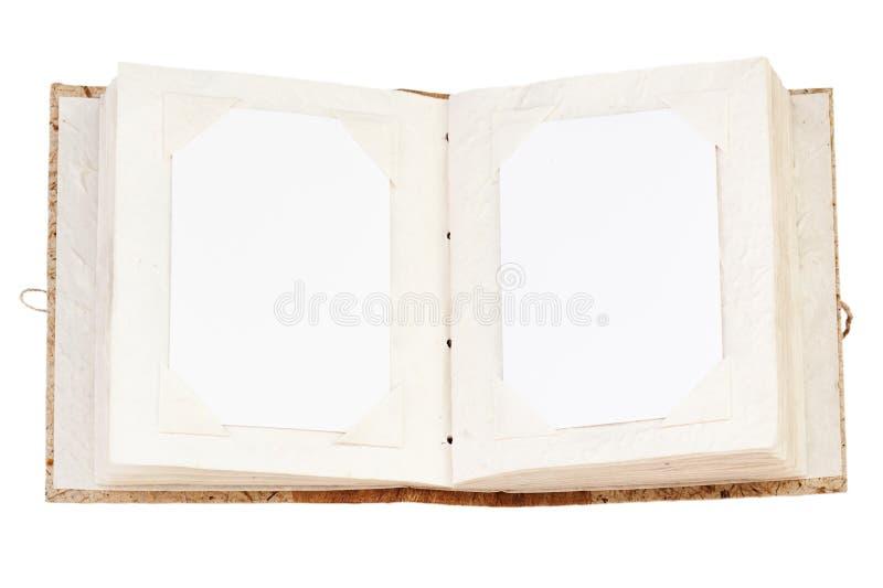 Apra il vecchio album di foto isolato su briciolo fotografie stock libere da diritti