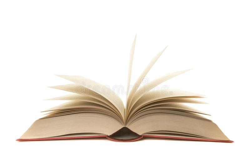 Apra il vecchio libro rosso con le pagine che stanno su su un fondo bianco fotografia stock libera da diritti