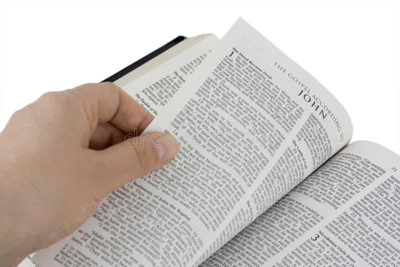Apra la bibbia immagine stock