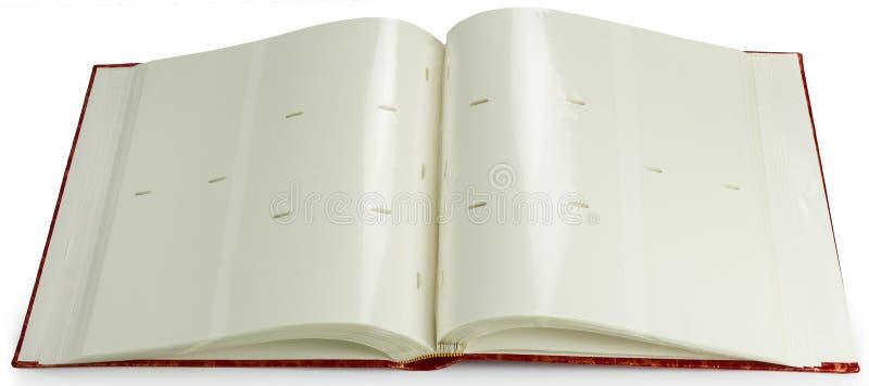 Apra un album di foto rosso in bianco del libro fotografia stock