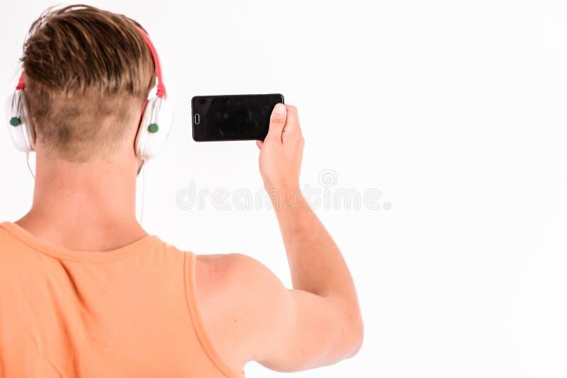 Aprecie fones de ouvido sadios da música perfeita Dispositivo da música da compra Dispositivos acessórios musicais da loja da loj foto de stock