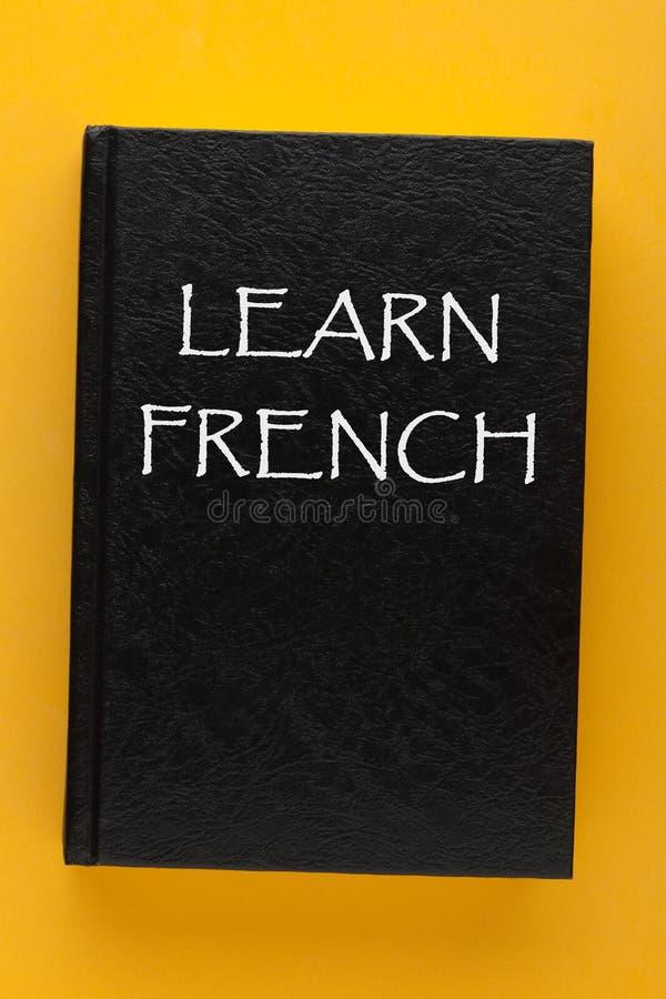 Aprenda o livro francês imagem de stock