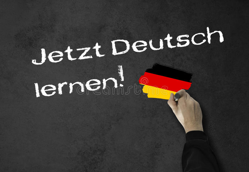 ¡Aprendiendo alemán ahora! foto de archivo