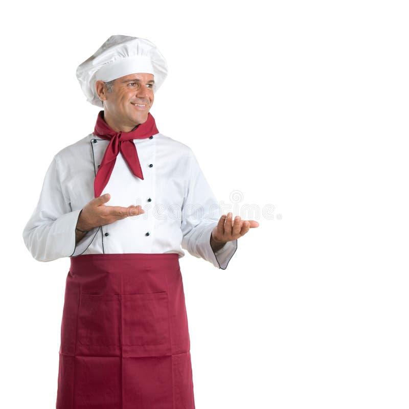Apresentação de sorriso do cozinheiro chefe fotos de stock royalty free