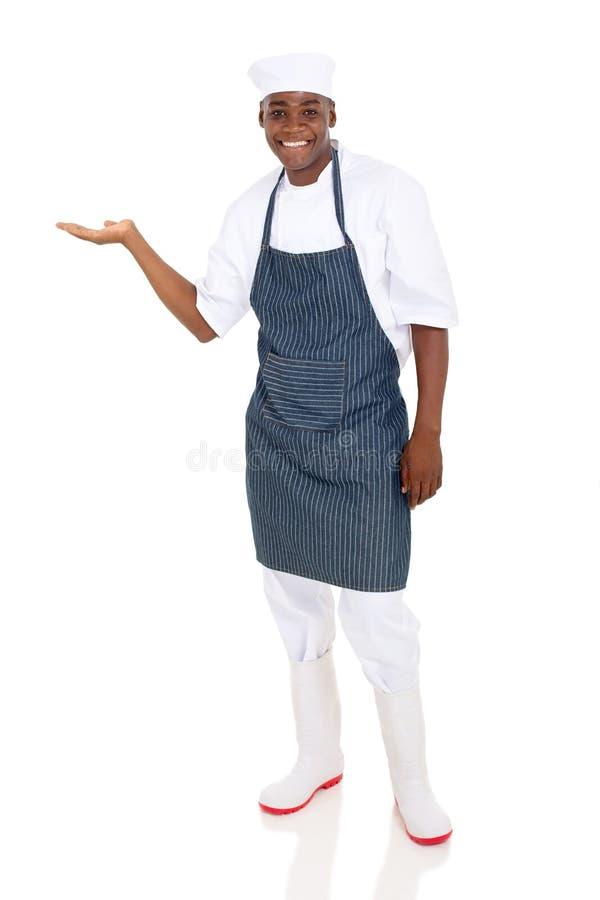 Apresentação masculina do cozinheiro chefe imagens de stock