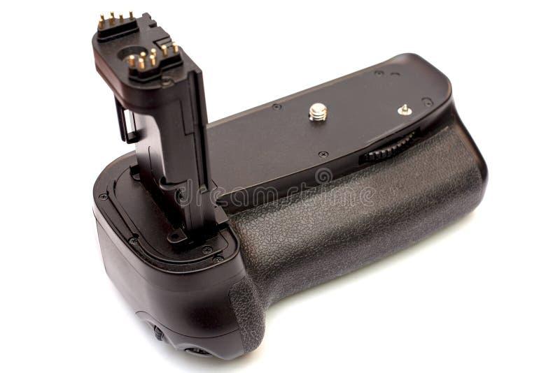 Apretón de la batería para la cámara moderna de DSLR aislada en el fondo blanco fotos de archivo libres de regalías