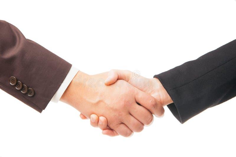 Apretón de manos de dos hombres de negocios aislados en el fondo blanco fotografía de archivo