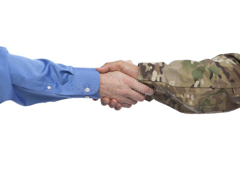 Apretón de manos de los militares y del hombre de negocios imagen de archivo libre de regalías