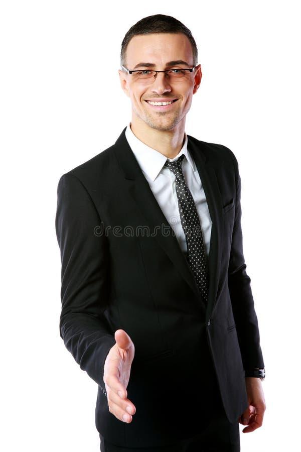 Apretón de manos de ofrecimiento del hombre de negocios hermoso imagen de archivo