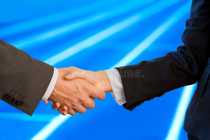 Apretón de manos de socios comerciales imagenes de archivo