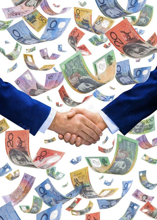 Apretón de manos del australiano del dinero que cae fotos de archivo