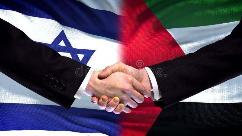 Apretón de manos de Israel y de Palestina, política internacional de la amistad, fondo de la bandera imagen de archivo libre de regalías