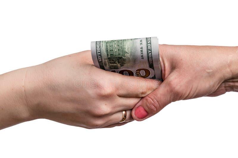 Apretones de manos con los billetes de banco del dólar fotos de archivo libres de regalías