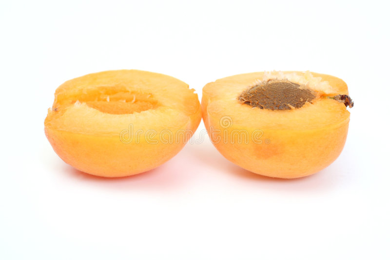 Apricot. Two halves Apricots on white background royalty free stock photo