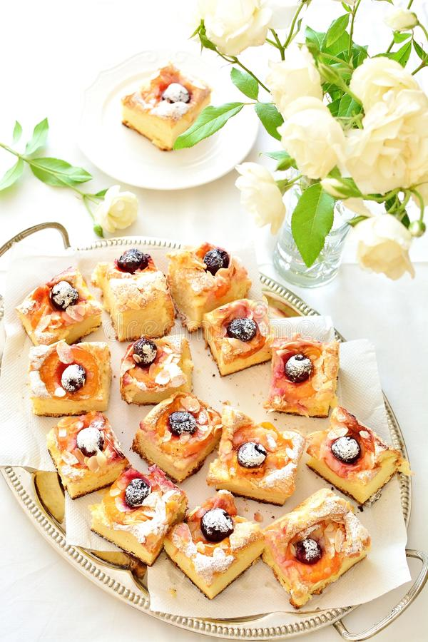 Apricot and cherry sponge cake royalty free stock image