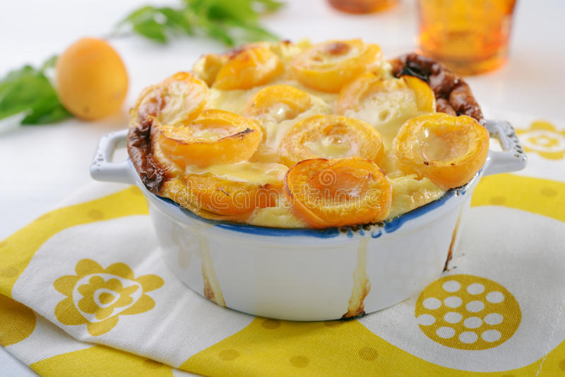 Apricot clafoutis. In a baking dish on a rustic table royalty free stock images