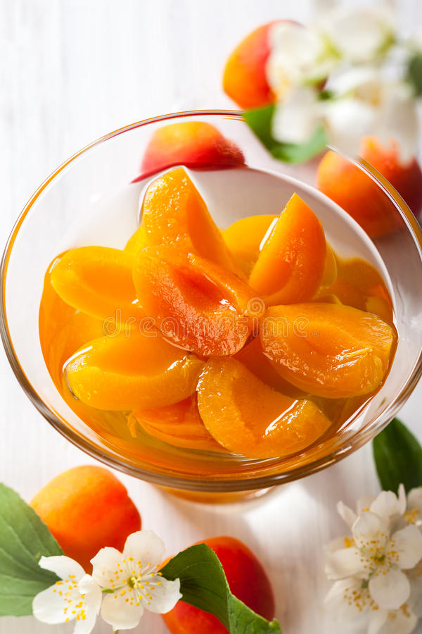 Apricot compote. Fresh apricot compote in glass bowl royalty free stock photo