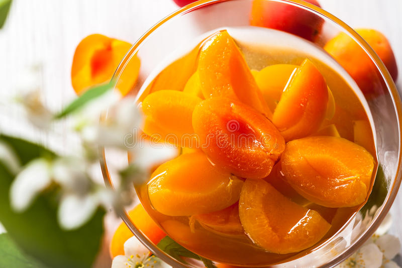 Apricot compote. Fresh apricot compote in glass bowl royalty free stock photography