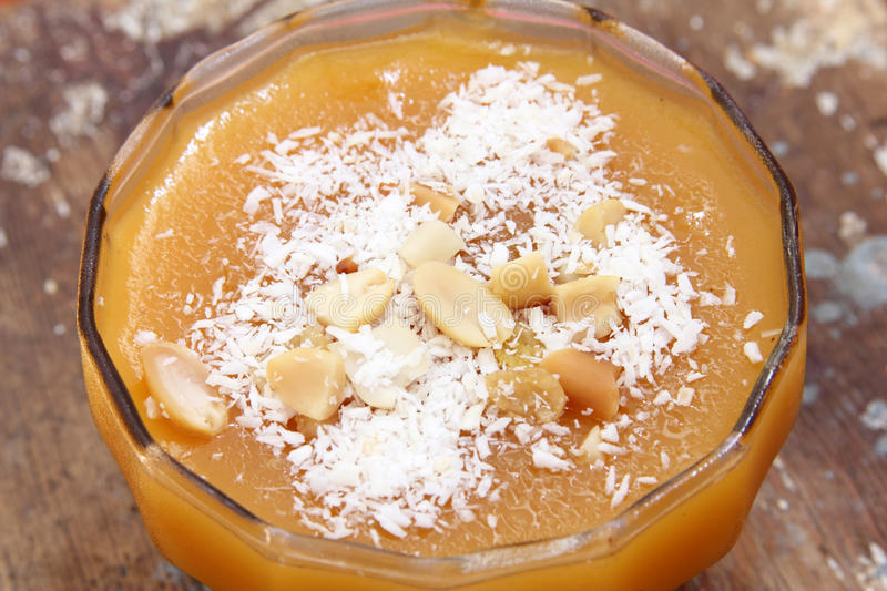 Apricot cream with nuts. Cup of arabian frozen apricot cream with nuts eaten in holy month ramadan royalty free stock photos